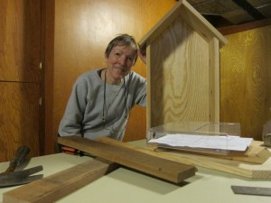Communications Committee member, MaryLouise Ott, builds the neighborhood kiosk prototype